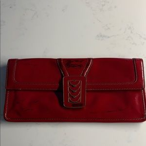 Cole Haan  red patent leather clutches